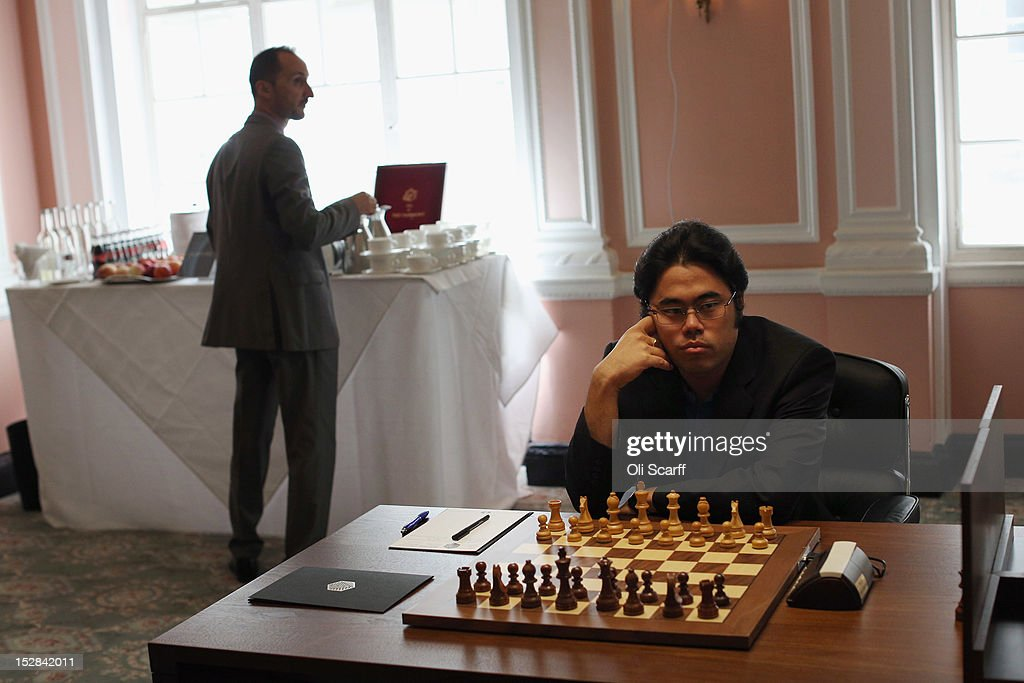 Chess Grandmasters <a gi-track='captionPersonalityLinkClicked' href=/galleries/search?phrase=Veselin+Topalov&family=editorial&specificpeople=2093743 ng-click='$event.stopPropagation()'>Veselin Topalov</a> (L) and Hikaru Nakamura (R) prepare to play in round 6 of the World Chess London Grand Prix at Simpson's-in-the-Strand on September 27, 2012 in London, England. The event, which begins the 2012/13 World Chess Championship Cycle, runs until October 3, 2012 and takes place over 11 rounds. The London Grand Prix is the first tournament in an ambitious, high-profile rebranding of world chess by American-born entrepreneur Andrew Paulson whose intention is to regain the global popularity chess enjoyed in the 1970s with matches between American Bobby Fischer and the Soviet Union's Boris Spassky.