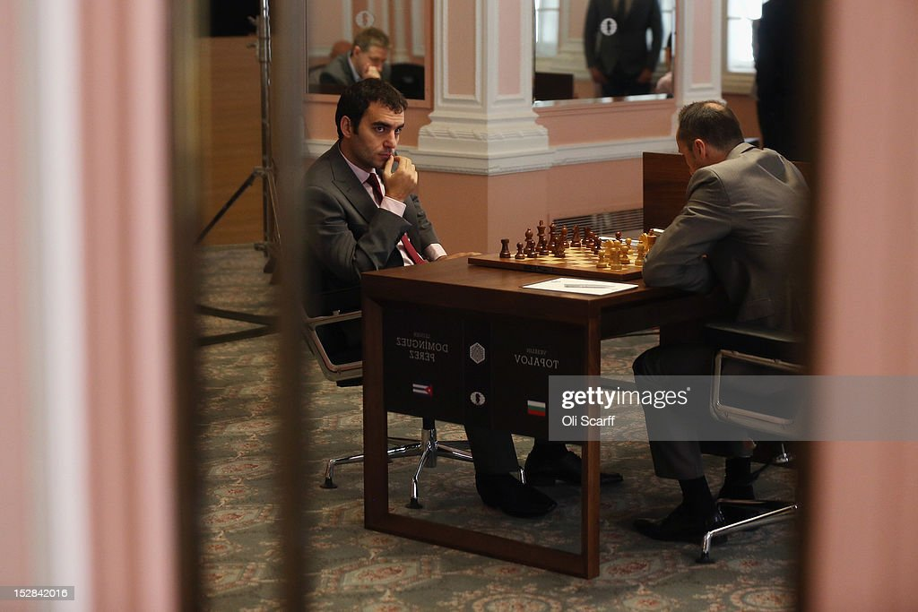Chess Grandmasters <a gi-track='captionPersonalityLinkClicked' href=/galleries/search?phrase=Veselin+Topalov&family=editorial&specificpeople=2093743 ng-click='$event.stopPropagation()'>Veselin Topalov</a> (R) and Leinier Dominguez Perez (C) play in round 6 of the World Chess London Grand Prix at Simpson's-in-the-Strand on September 27, 2012 in London, England. The event, which begins the 2012/13 World Chess Championship Cycle, runs until October 3, 2012 and takes place over 11 rounds. The London Grand Prix is the first tournament in an ambitious, high-profile rebranding of world chess by American-born entrepreneur Andrew Paulson whose intention is to regain the global popularity chess enjoyed in the 1970s with matches between American Bobby Fischer and the Soviet Union's Boris Spassky.