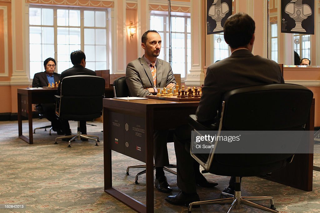 Chess Grandmasters <a gi-track='captionPersonalityLinkClicked' href=/galleries/search?phrase=Veselin+Topalov&family=editorial&specificpeople=2093743 ng-click='$event.stopPropagation()'>Veselin Topalov</a> (C) and Leinier Dominguez Perez (R) prepare to play in round 6 of the World Chess London Grand Prix at Simpson's-in-the-Strand on September 27, 2012 in London, England. The event, which begins the 2012/13 World Chess Championship Cycle, runs until October 3, 2012 and takes place over 11 rounds. The London Grand Prix is the first tournament in an ambitious, high-profile rebranding of world chess by American-born entrepreneur Andrew Paulson whose intention is to regain the global popularity chess enjoyed in the 1970s with matches between American Bobby Fischer and the Soviet Union's Boris Spassky.