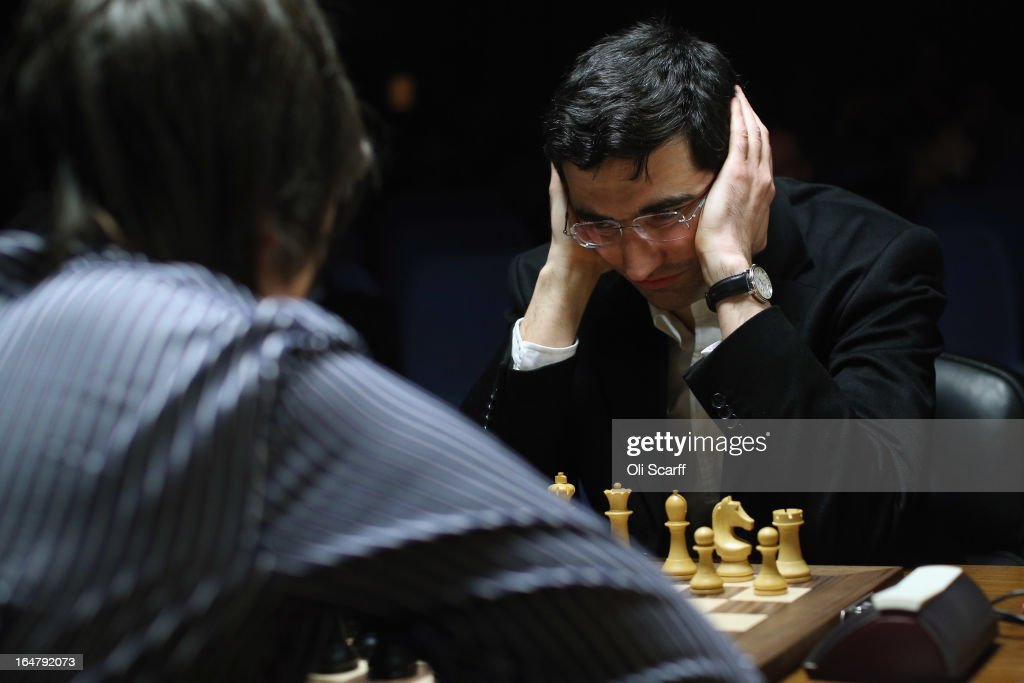 Chess grandmasters <a gi-track='captionPersonalityLinkClicked' href=/galleries/search?phrase=Vladimir+Kramnik&family=editorial&specificpeople=2394569 ng-click='$event.stopPropagation()'>Vladimir Kramnik</a> (R) and Teimour Radjabov play in the Candidates Tournament at the IET on Savoy Place on March 28, 2013 in London, England. The Candidates Tournament features eight of the world's top chess players and will determine which player will challenge Viswanathan Anand for the title of World Champion in November 2013. The tournament will be the strongest of its kind in history and have a total prize fund of 510,000 Euros.