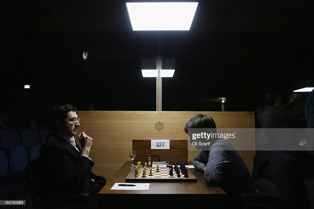 Chess grandmasters <a gi-track='captionPersonalityLinkClicked' href=/galleries/search?phrase=Vladimir+Kramnik&family=editorial&specificpeople=2394569 ng-click='$event.stopPropagation()'>Vladimir Kramnik</a> (L) and Teimour Radjabov play in the Candidates Tournament at the IET on Savoy Place on March 28, 2013 in London, England. The Candidates Tournament features eight of the world's top chess players and will determine which player will challenge Viswanathan Anand for the title of World Champion in November 2013. The tournament will be the strongest of its kind in history and have a total prize fund of 510,000 Euros.