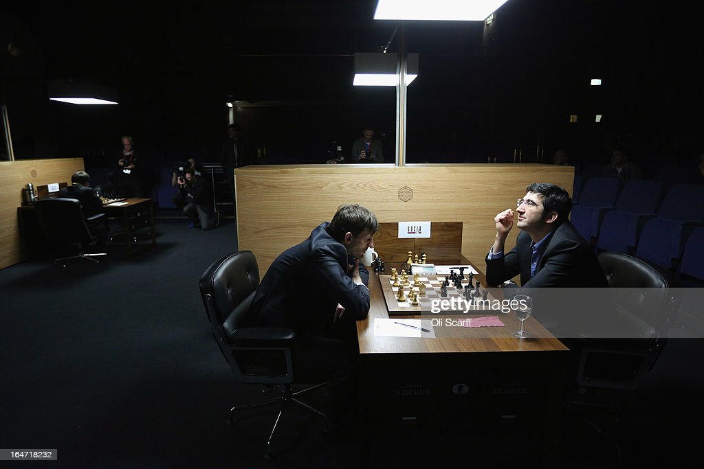 Chess grandmasters Vladimir Kramnik (R) of Russia and fellow countryman Alexander Grischuk compete in the Candidates Tournament, at the IET on Savoy Place on March 27, 2013 in London, England. The Candidates Tournament features eight of the world's top chess players to determine which player will challenge Viswanathan Anand for the title of World Champion in November 2013. The tournament will be the strongest of its kind in history with a total prize fund of 510,000 Euros.