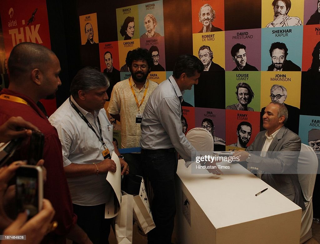 Chess legend Garry Kasparov signs autographs for his fans after his talk on 'How Life Imitates Chess: The Grandmaster's Battle For Russia' during the second day of THiNK 2013 at Bambolim on November 9, 2013 in Goa, India. THiNK is designed to be a unique platform for ideas, debates and conversations that are eclectic and engaging. And more often than not, the ideas and thoughts that come through from THiNK transcend immediate context, and hold relevance to our times, our society as well.