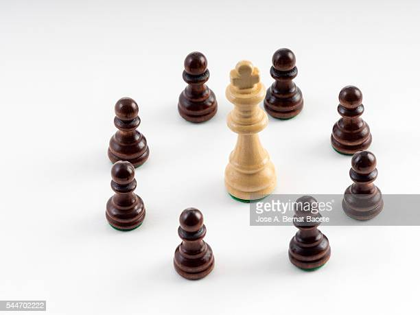 Chess pieces in a circle surrounding the king