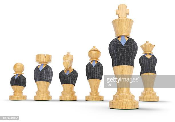 Chess pieces in business suit