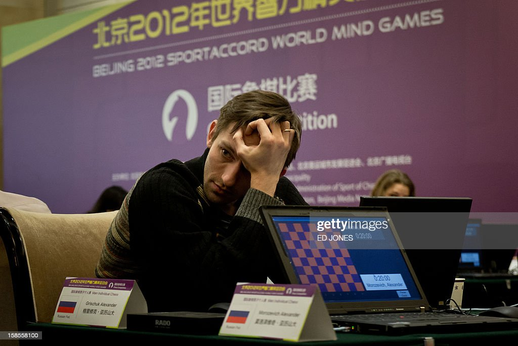 Chess player Alexander Grischuk of Russia prepares to compete in a 'blinfold' chess tournament at the Beijing 2012 World Mind Games Tournament in Beijing on December 19, 2012. Some of the world's top chess players went eye-to-eye in the year's highest-level 'blindfold' chess tournament -- seen by some as the toughest challenge in the game. Unable to physically see their own or their opponent's past moves, the players summoned headache-inducing levels of concentration to fight for gold in a silent conference room, lined up in front of laptop screens showing a blank board. AFP PHOTO / Ed Jones