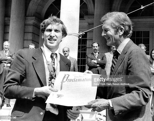 Chess player Bobby Fischer receives proclamation from Mayor John Lindsay at City Hall New York