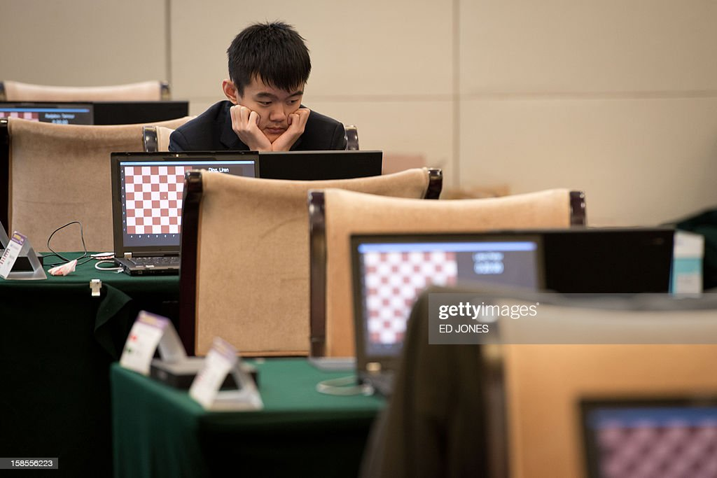 Chess player Ding Liren of China prepares to compete in a 'blinfold' chess tournament at the Beijing 2012 World Mind Games Tournament in Beijing on December 19, 2012. Some of the world's top chess players went eye-to-eye in the year's highest-level 'blindfold' chess tournament -- seen by some as the toughest challenge in the game. Unable to physically see their own or their opponent's past moves, the players summoned headache-inducing levels of concentration to fight for gold in a silent conference room, lined up in front of laptop screens showing a blank board. AFP PHOTO / Ed Jones