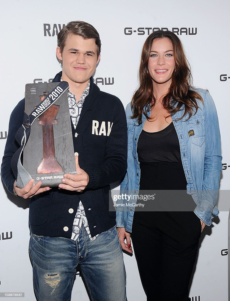 Chess player <a gi-track='captionPersonalityLinkClicked' href=/galleries/search?phrase=Magnus+Carlsen&family=editorial&specificpeople=2602660 ng-click='$event.stopPropagation()'>Magnus Carlsen</a> and actress <a gi-track='captionPersonalityLinkClicked' href=/galleries/search?phrase=Liv+Tyler&family=editorial&specificpeople=202094 ng-click='$event.stopPropagation()'>Liv Tyler</a> attend the G-Star RAW World Chess Challenge at The Cooper Square Hotel on September 10, 2010 in New York City.