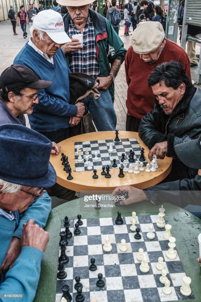 Chess players gather out in public by the main bus station, Valparaiso, UNESCO World Heritage Site, Chile : Stock Photo