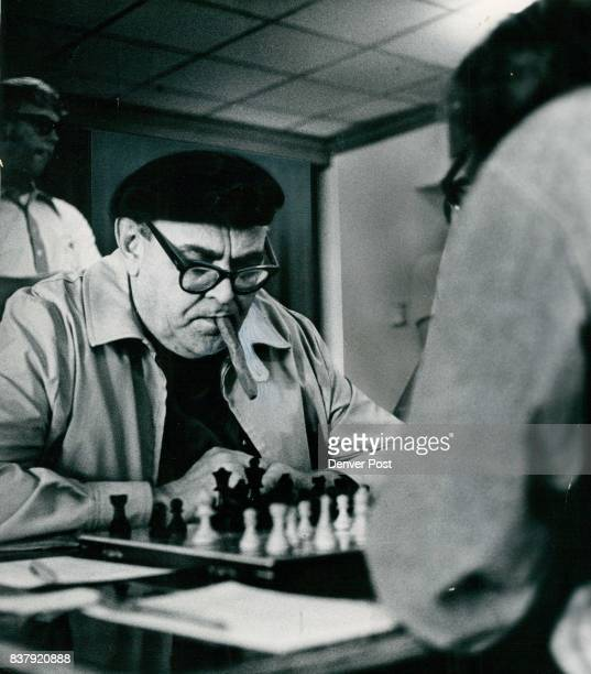 Chess Players Ponder Strategy At Colorado Tournament Rudolf Petters Henderson Colo puffs and studies board and his opponent Ken Case of Manitou...