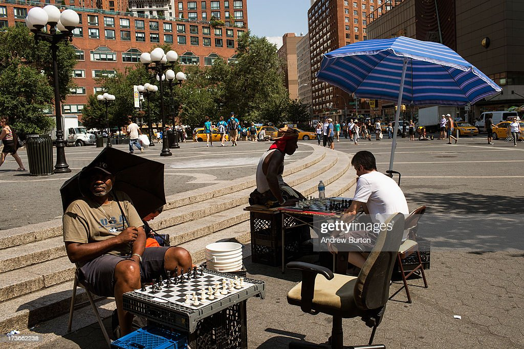 Chess players use umbrellas to find shade in Union Square on July 16, 2013 in New York City. A stifling heat wave has descended upon the New York City region for the week; temperatures are expected to reach into the 100s.