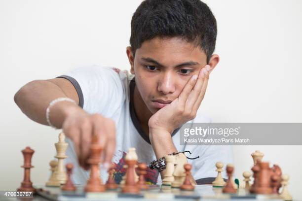 Chess prodigy Fahim Alam is photographed at home for Paris Match on February 13 2014 in Creteil France