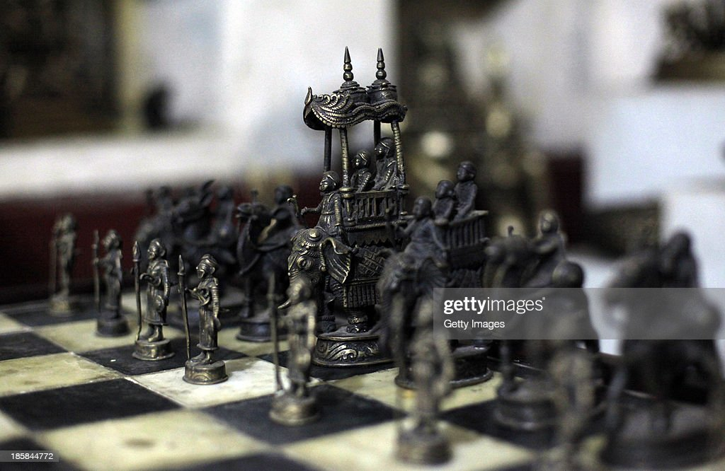 A chess set is displayed at Dhamrai Metal Crafts on October 5, 2013 in Dhaka, Bangladesh. The owner of the metal crafts shop, Sukanta Banik, creates bronze sculptures in the art of 'lost wax casting.' The business has been in his family for 200 years. The pieces are first molded in wax, then encased in clay, then baked in the oven, after which metal is poured into the mold. One piece can take up to 10 months to make. The business is suffering because most of these items he creates can now be mass produced in plastic, and as a Hindu artist working in Islamic Bangladesh, the 'depiction of all humans and animals are discouraged by the majority religion.' Recently it took a year and a half to send an order overseas, when Bangladeshi customs held his work in hopes for a bribe.
