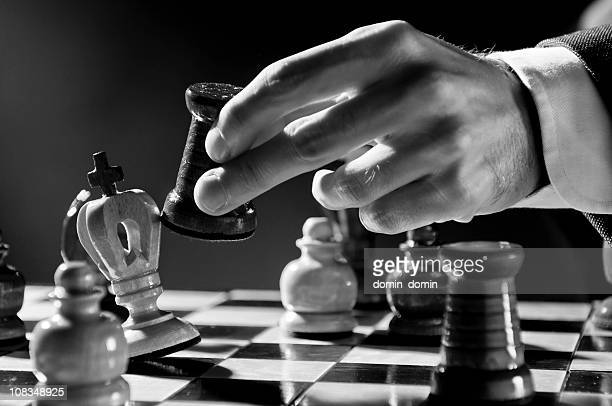 Chess Strategy, Chess player, businessman making checkmate move, black white