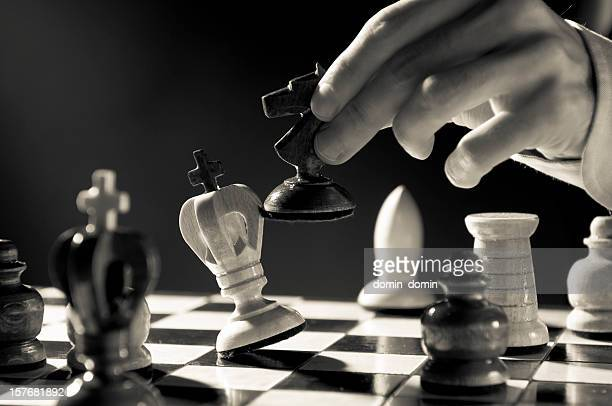 Chess Strategy, Chess player, businessman making checkmate move, sepia toned