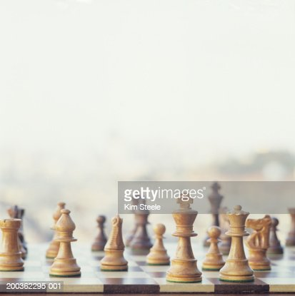 Chessboard with carved wooden pieces