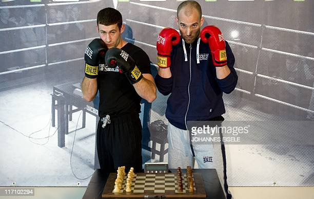 Chessboxers Lukas 'Frog' Kosowski starting for Berlin and Daniel Rivas Lizarraga starting for London pose behind a chessboard after a press...