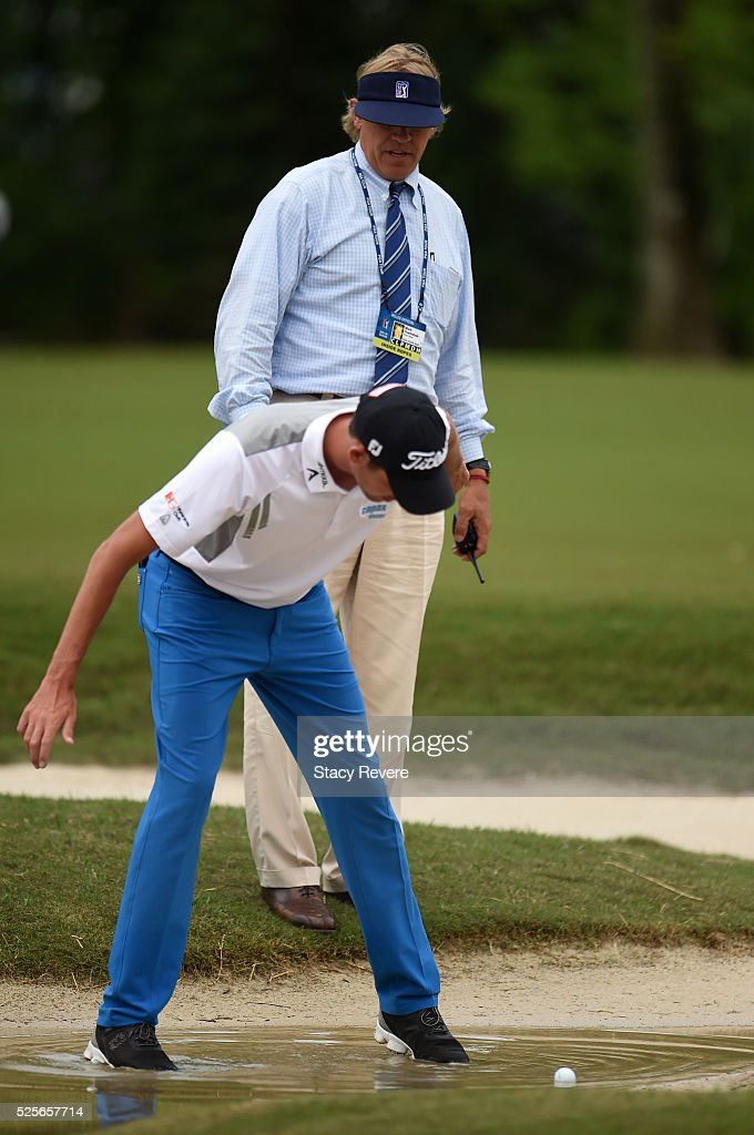 Chesson Hadley checks the lie of his ball on the 16th hole during the first round of the Zurich Classic of New Orleans at TPC Louisiana on April 28, 2016 in Avondale, Louisiana.