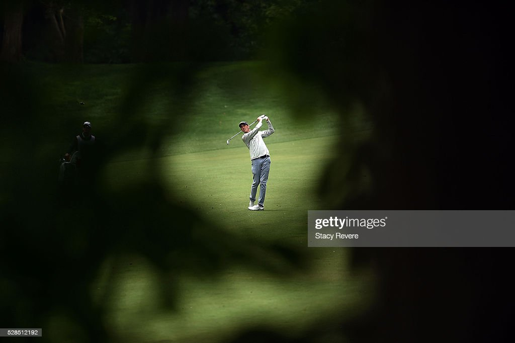 Chesson Hadley hits his approach shot on the 12th hole during the first round of the Wells Fargo Championship at Quail Hollow on May 5, 2016 in Charlotte, North Carolina.