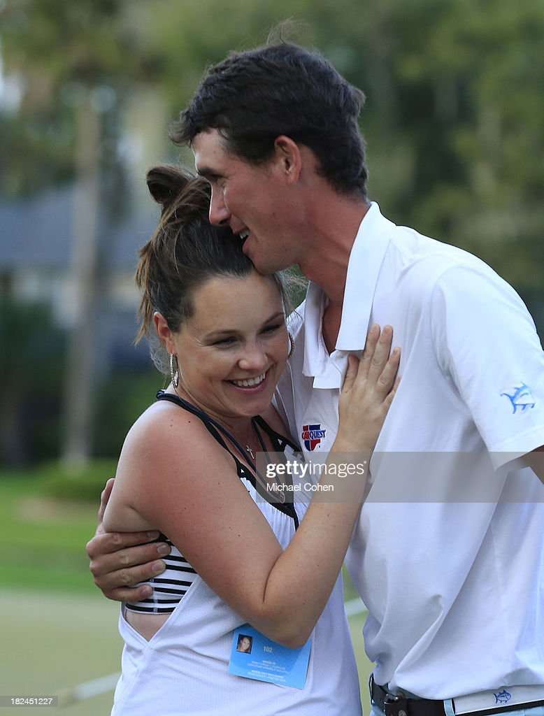 Chesson Hadley (R) hugs his wife Amanda on the 18th green after winning the Web.com Tour Championship held on the Dye's Valley Course at TPC Sawgrass on September 29, 2013 in Ponte Vedra Beach, Florida.