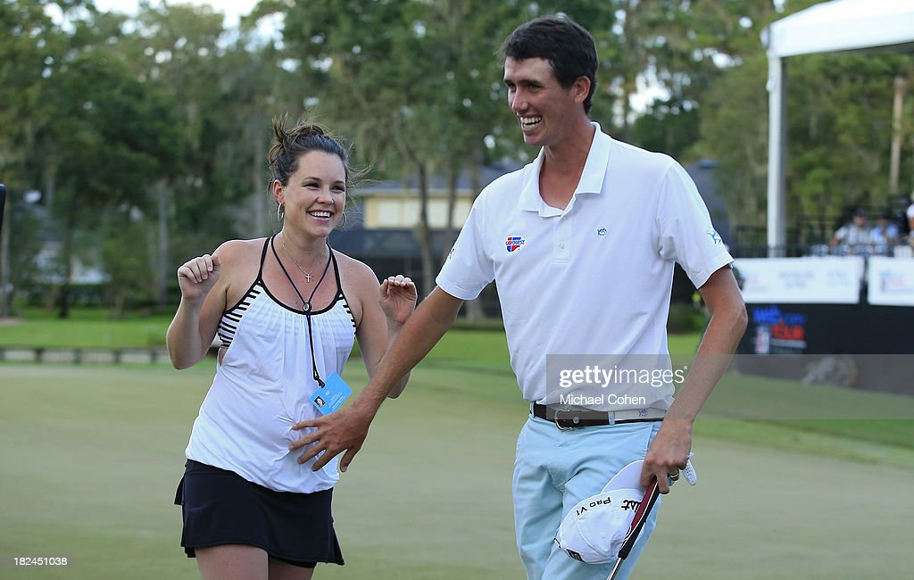 Chesson Hadley pats the belly of his pregnant wife Amanda after winning the Web.com Tour Championship held on the Dye's Valley Course at TPC Sawgrass on September 29, 2013 in Ponte Vedra Beach, Florida.