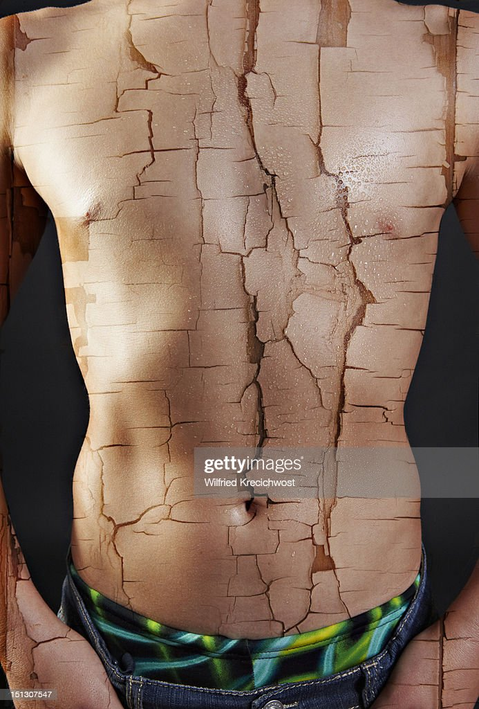 Chest Of A Boy With Cracked Paint Effect Stock Photo ...