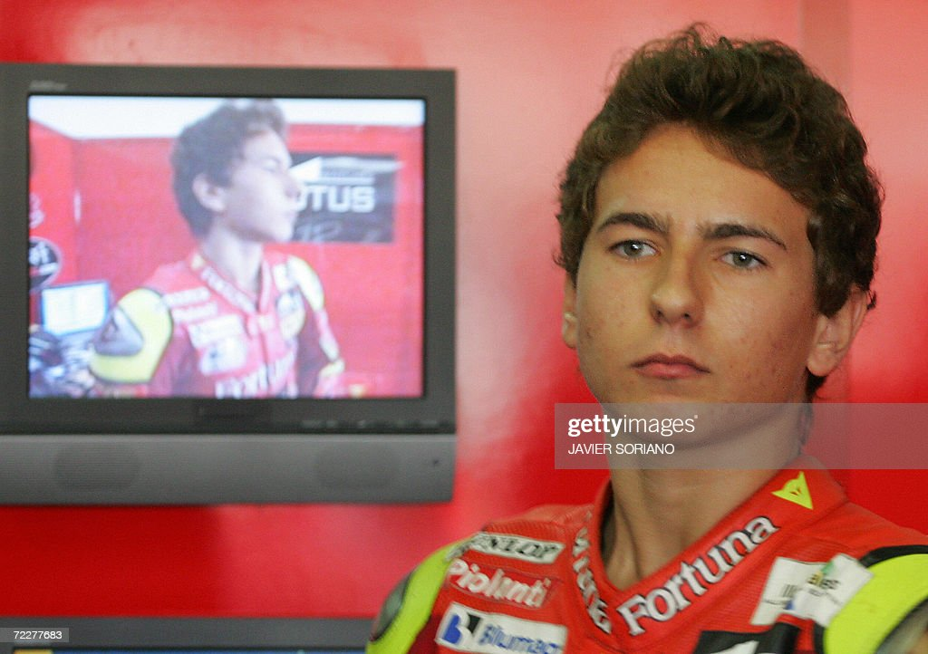 Spain's Jorge Lorenzo looks at the results after a 250cc qualifying session at the Valencia Grand Prix at the Ricardo Tormo Race track in Cheste near...