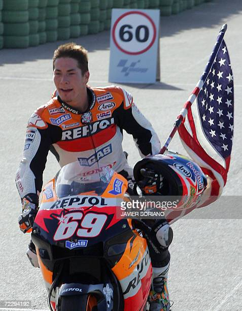 US Nicky Hayden arrives to box area after winning the 2006 championship in the GP category after the Valencia Grand Prix at the Ricardo Tormo...