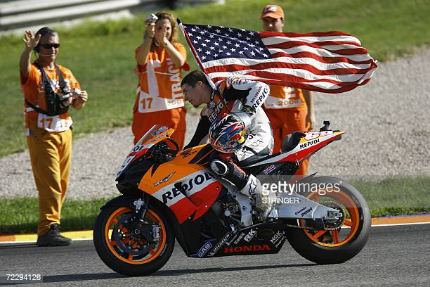 US Nicky Hayden does a victory lap after winning the 2006 Moto GP championship at the end of season Valencia Grand Prix at the Ricardo Tormo...