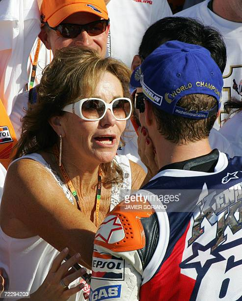 US Nicky Hayden is congratulated by his mother after winning the 2006 Moto GP championship at the end of season Valencia Grand Prix at the Ricardo...