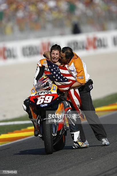 US Nicky Hayden is greeted by a team member after winning the 2006 MotoGP world championships at the Valencia Grand Prix in Cheste 29 October 2006...