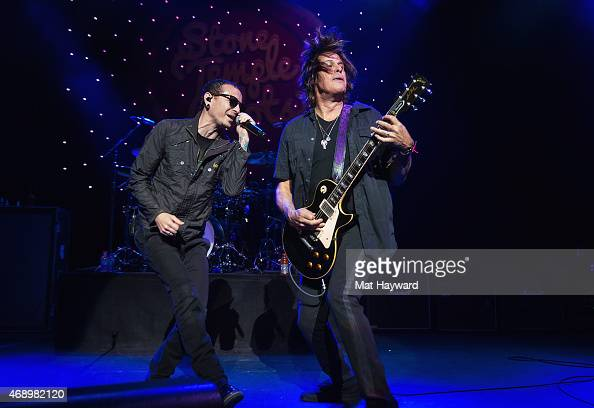 Chester Bennington and Dean DeLeo of Stone Temple Pilots perform on stage during the opening night of the tour at The Paramount Theater on April 8...