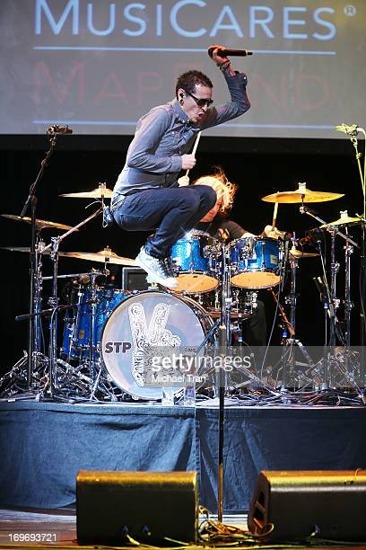 Chester Bennington and Eric Kretz of Stone Temple Pilots perform onstage during the 9th Annual MusiCares MAP Fund Benefit Concert held at Club Nokia...