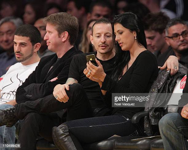 Chester Bennington and his wife Talinda Bentley attend a game between the Portland Trail Blazers and the Los Angeles Lakers at Staples Center on...