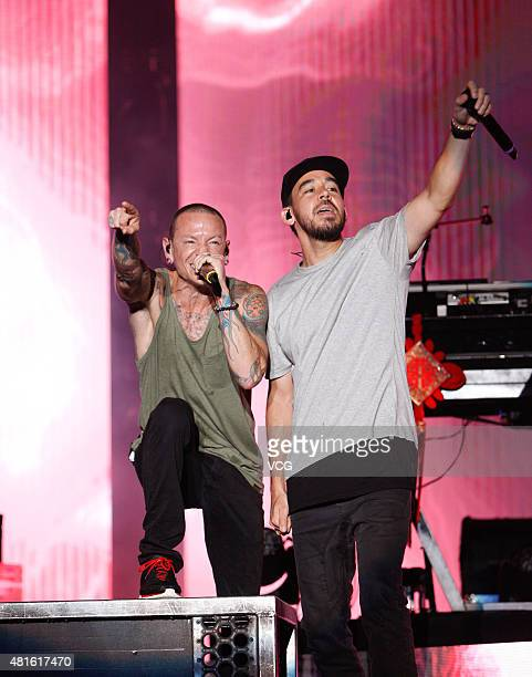 Chester Bennington and Mike Shinoda of Linkin Park perform onstage during The Hunting Party 2015 China Tour at Hongkou Football Stadium on July 22...