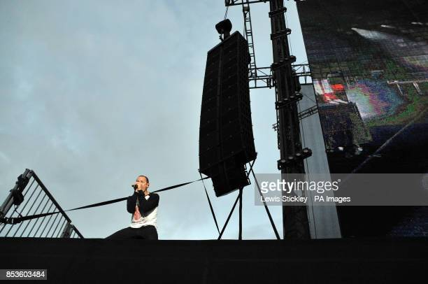 Chester Bennington of Linkin Park performs beside the stage during day two of the 2014 Download Festival at Donington Park
