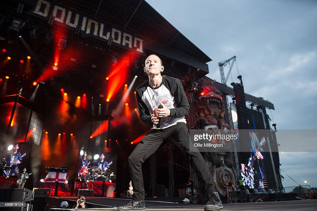 <a gi-track='captionPersonalityLinkClicked' href=/galleries/search?phrase=Chester+Bennington&family=editorial&specificpeople=213970 ng-click='$event.stopPropagation()'>Chester Bennington</a> of Linkin Park performs on stage headlining day 2 of Download Festival at Donnington Park on June 14, 2014 in Donnington, United Kingdom.