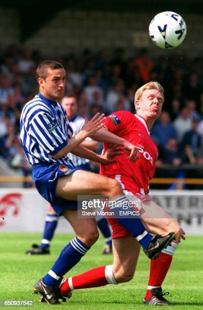 Chester City's Neil Fisher challenges Peterborough United's David Oldfield