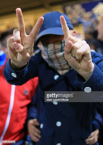 Chester fan with his face covered by a Burberry scarf signifies the 21 scoreline during the Vanarama Conference match between Chester and Wrexham at...