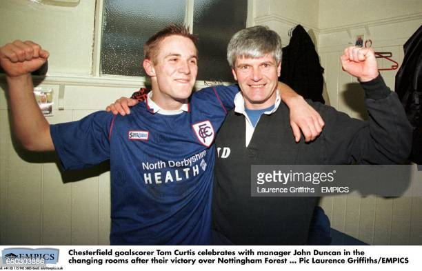 Chesterfield goalscorer Tom Curtis celebrates with manager John Duncan in the changing rooms after their victory over Nottingham Forest