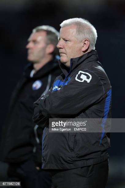 Chesterfield manager John Sheridan stands behind Tranmere Rovers manager Les Parry on the touchline