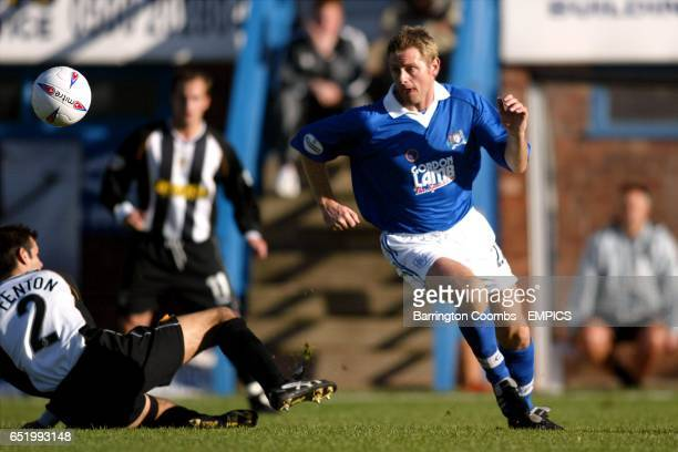 Chesterfield's David Reeves and Notts County's Nick Fenton battle for the ball