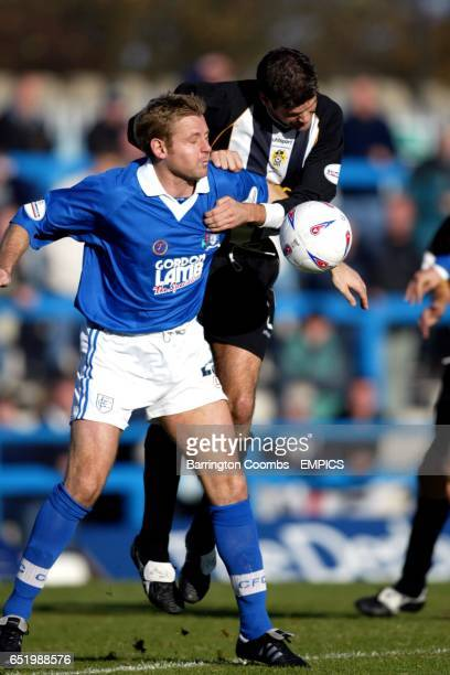 Chesterfield's David Reeves and Notts County's Nick Fenton fight for the ball