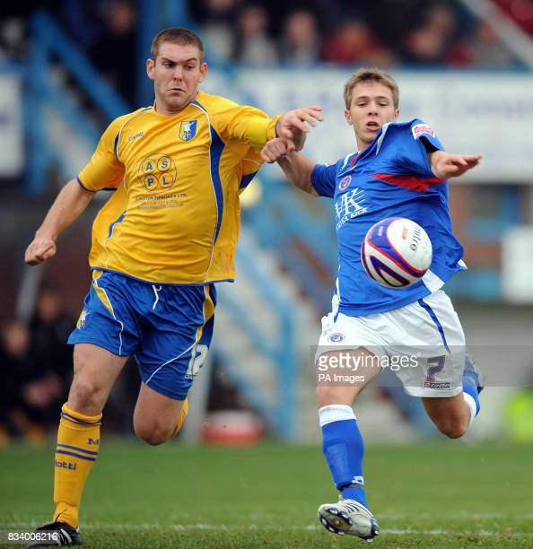 Chesterfield's Jamie Ward and Mansfield Town's Jake Buxton in action during the CocaCola Football League Two match at the Recreation Ground...