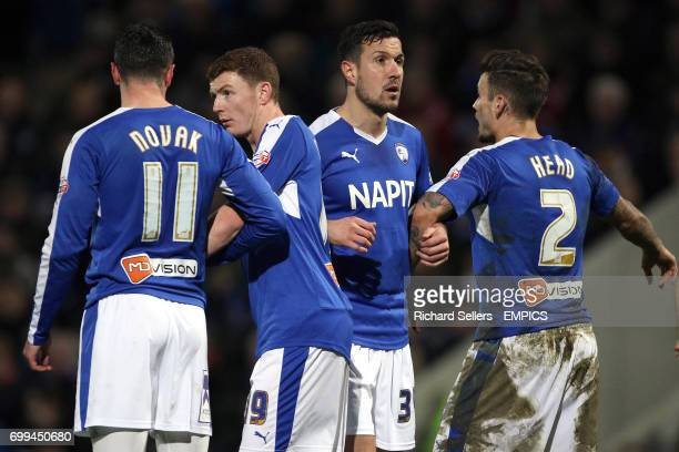Chesterfield's Lee Novak Dion Donohue Richard Wood and Chris Herd form a defensive wall