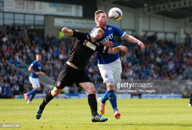 Chesterfield's Ritchie Humphreys and Fleetwood Town's Steven Schumacher during the Sky Bet League Two match at the Proact Stadium Chesterfield
