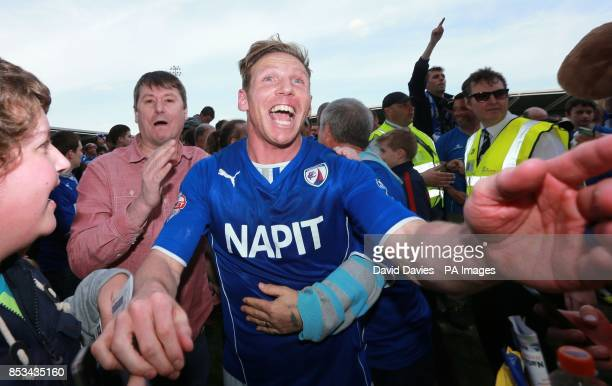 Chesterfield's Ritchie Humphreys celebrates winning the Sky Bet League Two at the Proact Stadium Chesterfield