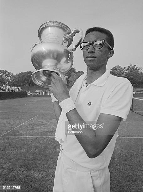 Army lieutenant Arthur Ashe proudly displays trophy after winning the US Men's Singles Tennis Championship at Longwood Cricket Club August 25th Ashe...
