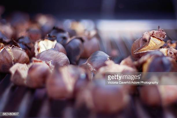 Chestnuts roasting outside on a grill